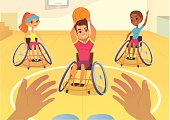 Handisport. Boys and girls in wheelchairs playing baysball in a