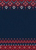 Handmade knitted background pattern with scandinavian ornaments