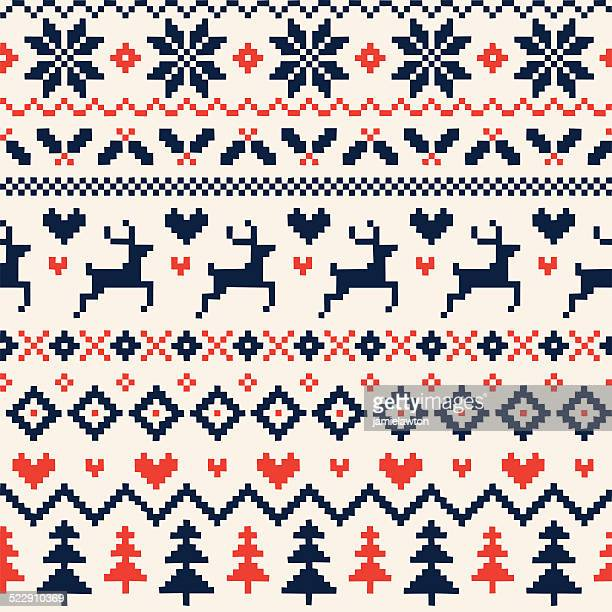 handmade seamless christmas pattern with reindeer, hearts, christmas trees and snowflakes - jumper stock illustrations