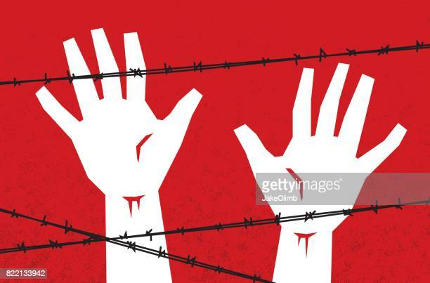 Hands Behind Barbed Wire