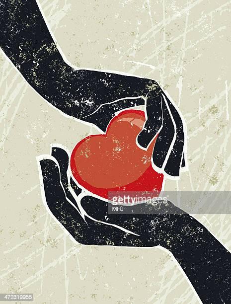 Hand's Cradling a Heart