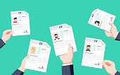 Hands holding CV papers. Human resources management concept, searching professional staff