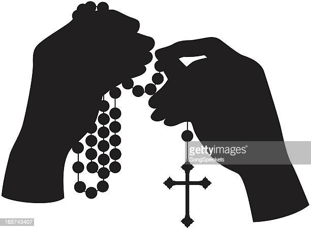 hands holding rosary silhouette - rosary beads stock illustrations