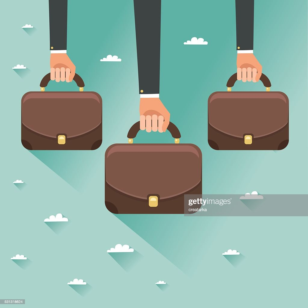 Hands of businessmen holding briefcases