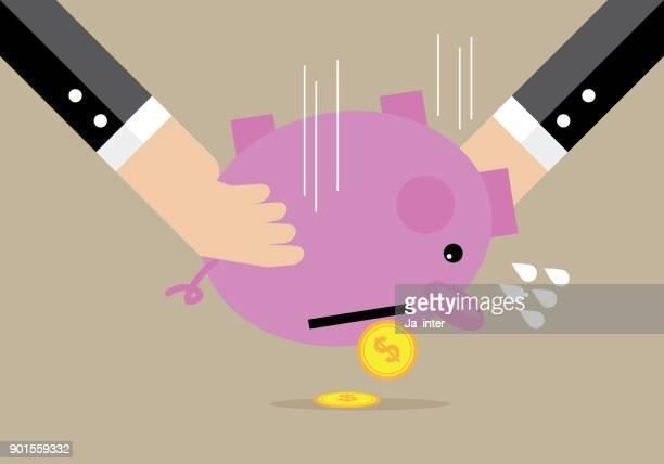 Hands shaking piggy bank
