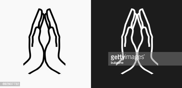 hands together icon on black and white vector backgrounds - praying stock illustrations, clip art, cartoons, & icons