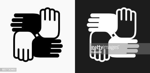 hands united icon on black and white vector backgrounds - diversity stock illustrations