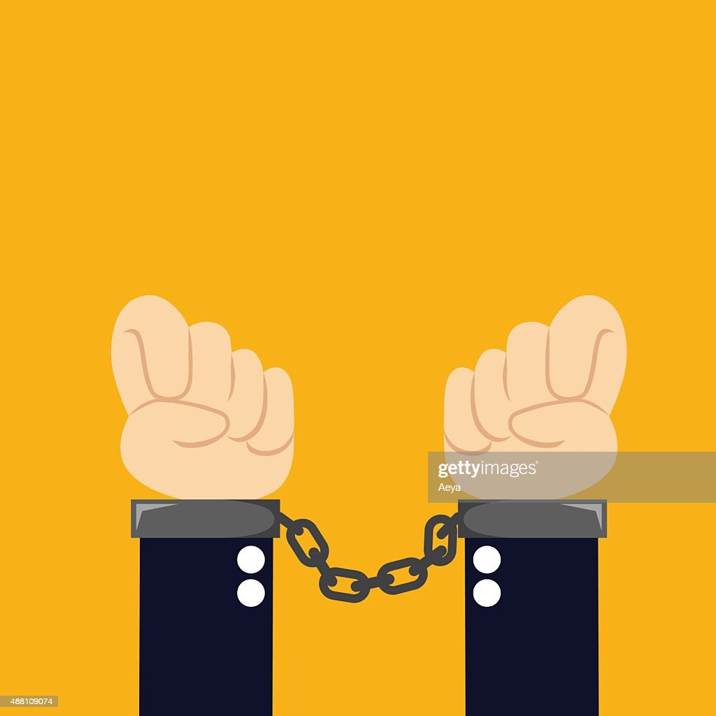 Hands with closed manacles on his hands on orange background