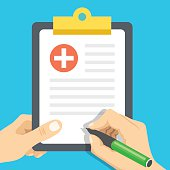 Hands with pen and medical clipboard. Clinical record, medical report