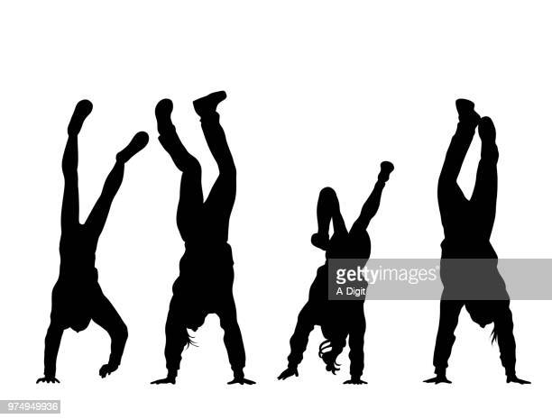 handstand girls - gymnastics stock illustrations