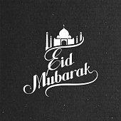 handwritten Eid Mubarak retro label.
