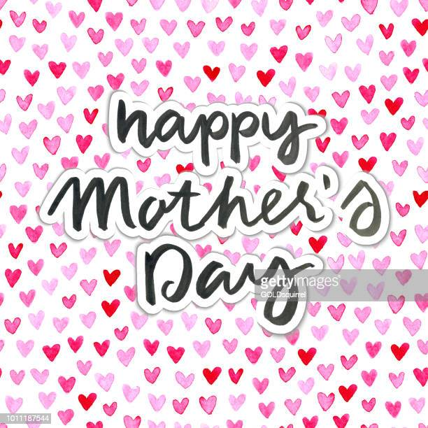 happy mother's day handwritten text on background made of watercolor painted tiny heart shapes - mothers day text art stock illustrations