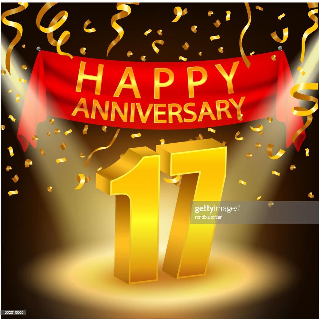 Happy 17th Anniversary celebration with golden confetti and spotlight