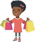 Happy african-american girl holding shopping bags