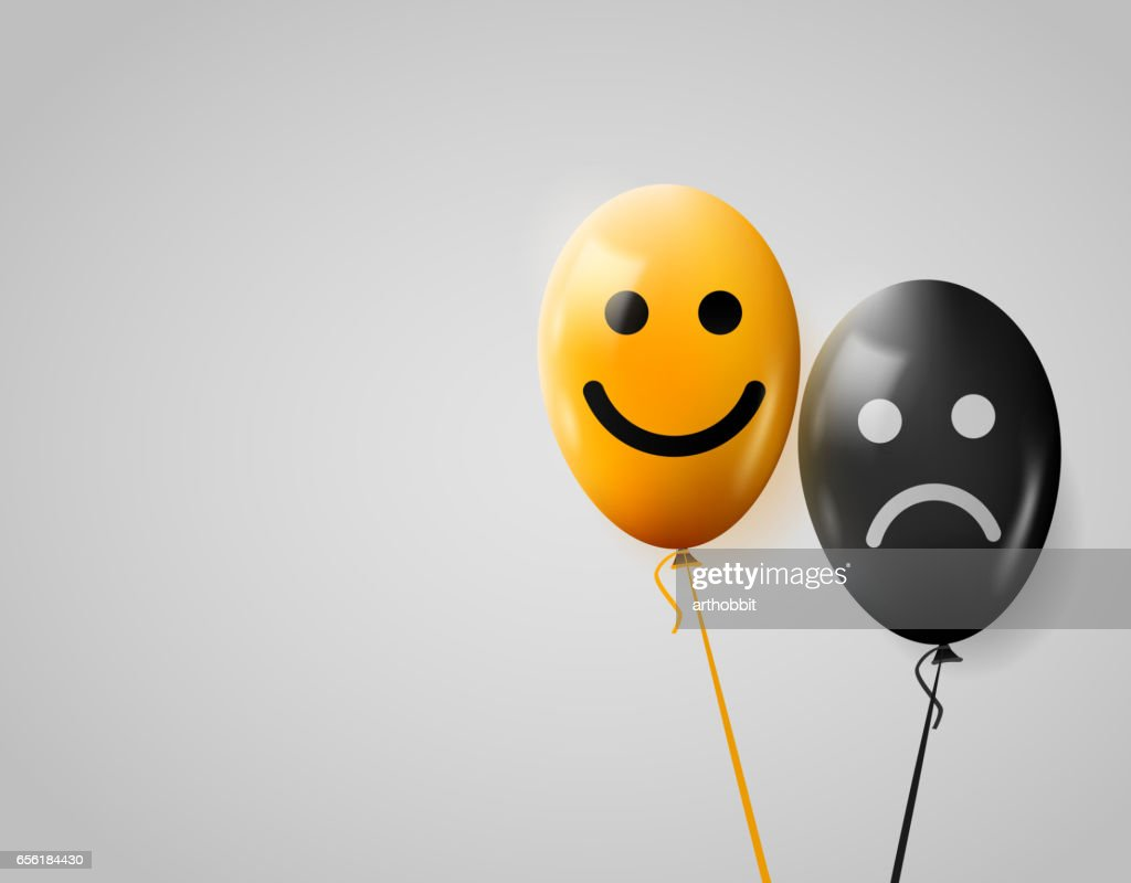 Happy and sad faces. Yellow and black balloons.