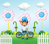 happy boy at the candyland with his bike