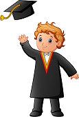 Happy boy in black graduation gown
