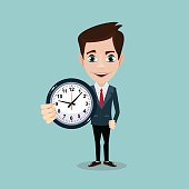 Happy businessman stand leaning to big clock. Concept of time management