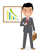 Happy businessman with graphics