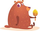 Happy cartoon brown bear with honey wooden stick. Vector illustration isolated
