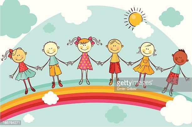Glückliche Kinder halten Hände auf Regenbogen