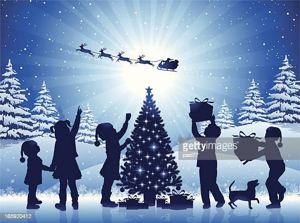 ilustraciones, imágenes clip art, dibujos animados e iconos de stock de niños felices en la noche de navidad - decorar