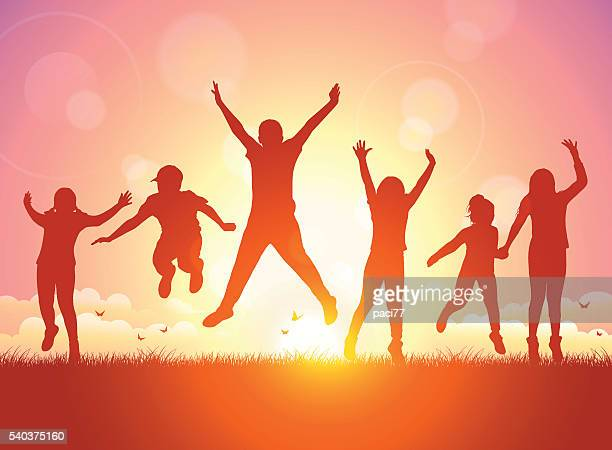 Happy Children jumping on Sunset