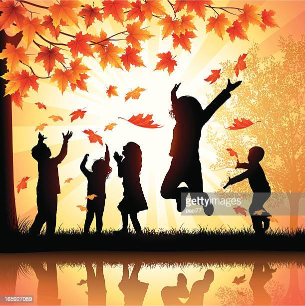 Happy Children Playing with Leaves