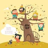Happy children sitting on tree in autumn park