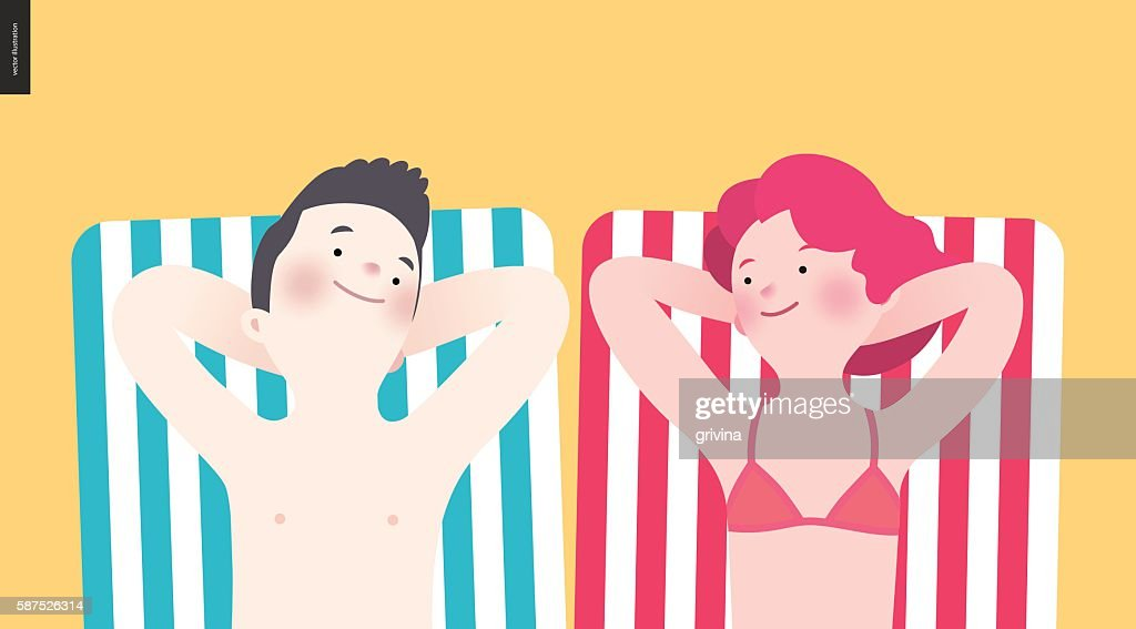 Happy couple sunbathing on the beach