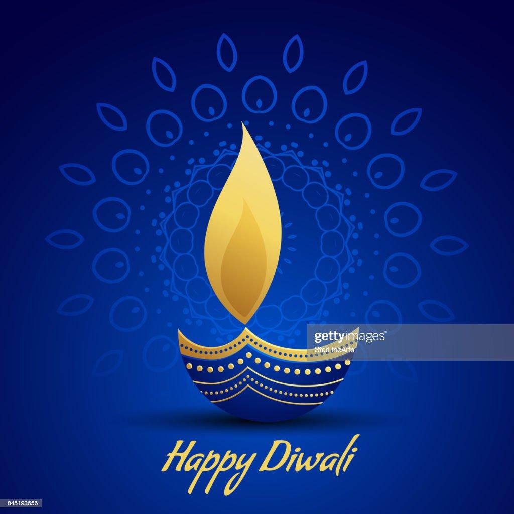 happy diwali festival greeting with decorative diya lamp on blue background