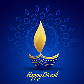 happy diwali festival greeting with decorative diya lamp on blue background