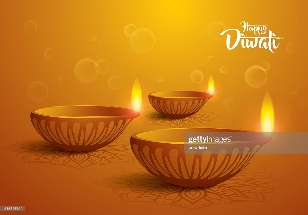 happy diwali. traditional indian diya oil lamp.