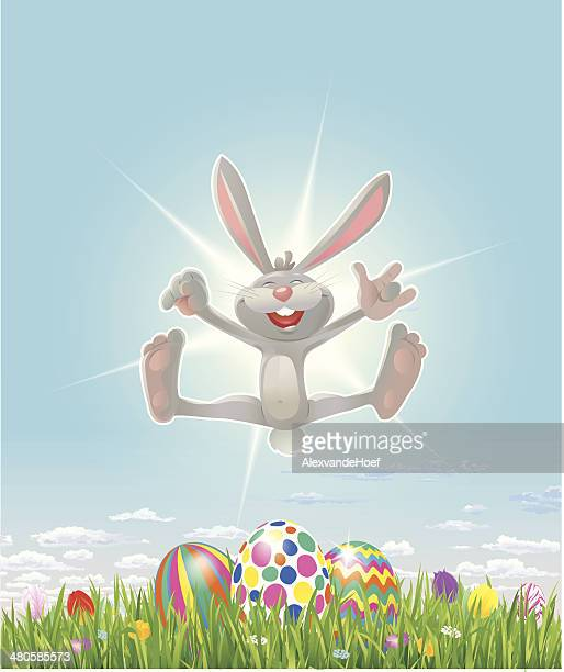 happy easter bunny with eastereggs grass and tulips - easter bunny stock illustrations, clip art, cartoons, & icons