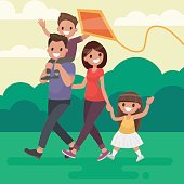 Happy family walks outdoors and launches a kite