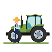 Happy Farmer standing next to the new tractor. Machinery for
