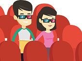 Happy friends watching 3D movie in the theatre