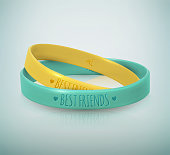 Happy Friendship Day. Realistic yellow and turquoise rubbers friendship bracelets for best friends.