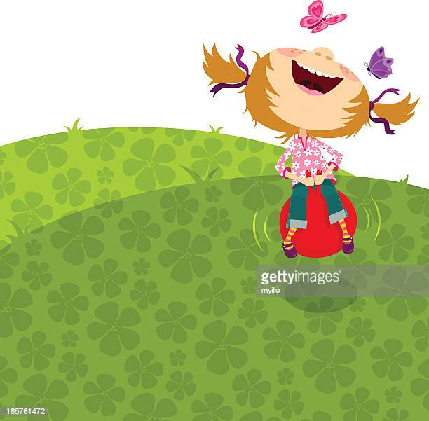 Happy girl jumping, bouncing on a hopper ball.