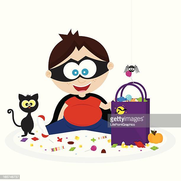 happy little boy with his halloween candy! - milk chocolate stock illustrations, clip art, cartoons, & icons