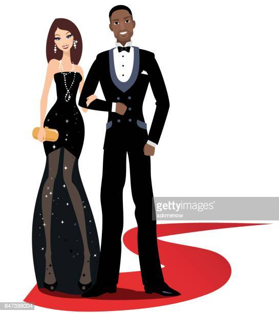 Happy mixed couple on a red carpet