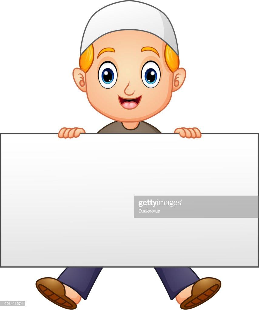 Happy muslim boy cartoon holding blank sign