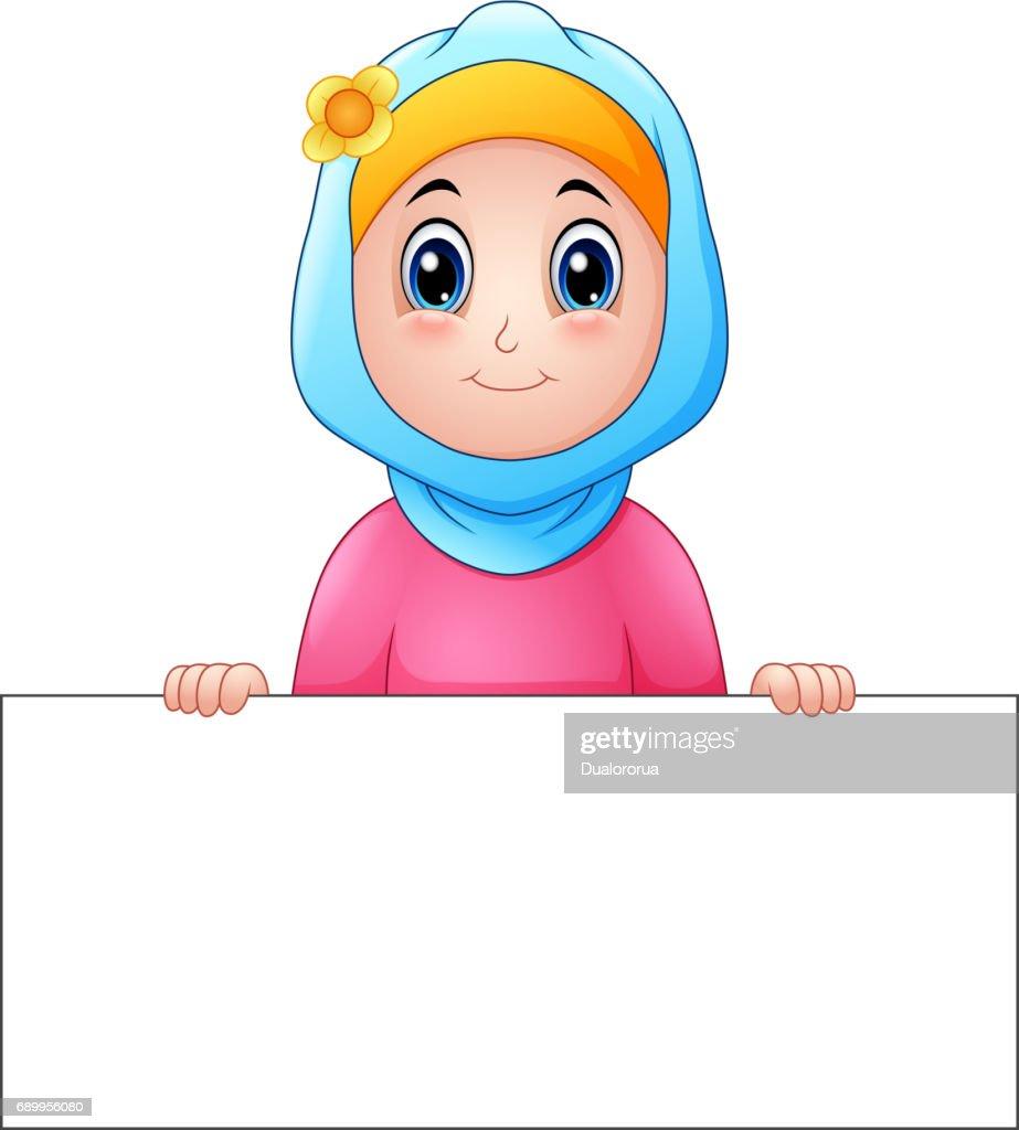 Happy muslim girl wearing blue veil holding blank sign