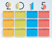 Happy New Year 2015 celebration with yearly calendar.
