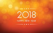 happy new year 2018 with bokeh and lens flare pattern on summer orange color background