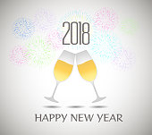 Happy new year 2018 with champagne glasses and firework bacground