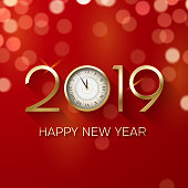 Happy New Year 2019 greeting card with clock and bokeh effect.