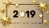 Happy New Year 2019 greeting card with golden clock and stars.