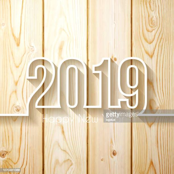 happy new year 2019 - on wooden background - pine wood material stock illustrations, clip art, cartoons, & icons