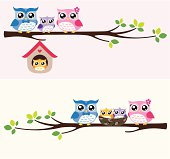 happy owls family sitting on a tree branch
